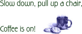 photo of a cup of steaming coffee with cookies beside it. Coffee is on!